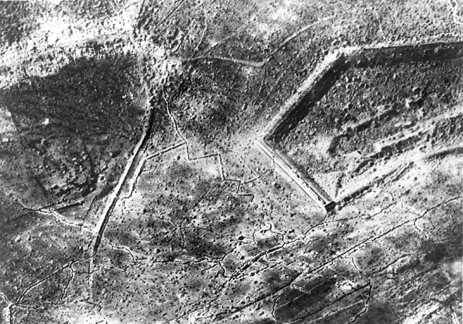 On the 31st the French were again hard pressed when Fort Vaux was besieged. Although pummeled by an estimated 8,000 shells a day, it did not fall as quickly as Douaumont had. Here we see an aerial view of the shelling.