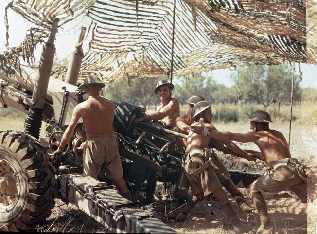 Above, British gunners of the Shropshire Yeomanry operating a 5.5-inch howitzer in Italy during World War II are not wearing camouflage themselves, but are well-concealed under camouflage netting.