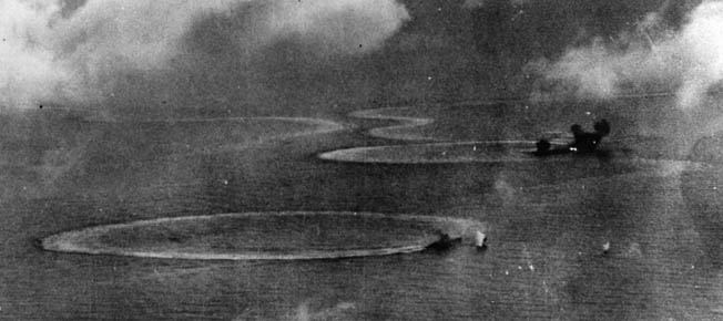 Jisaburo Ozawa sought to cripple Mitscher's Task Force 58 in the Battle of the Philippine Sea, which became known as the Great Marianas Turkey Shoot.