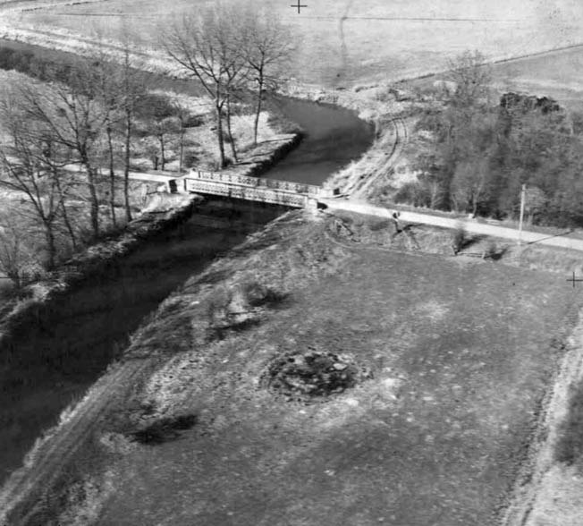 The destruction of the Robehomme Bridge, shown in this photograph taken from an aerial reconnaissance plane in March 1944, was the responsibility of Company B, 1st Canadian Parachute Battalion.