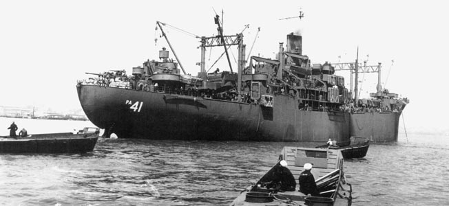 The crew of the attack transport DuPage braved kamikaze attacks while supporting American landings in the Philippines.