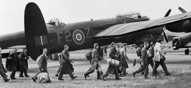 The Lancaster played a significant role in the repatriation of British prisoners of war after World War II ended. In this photo a group of former POWs walk toward the Lancaster that will carry them home to Britain.