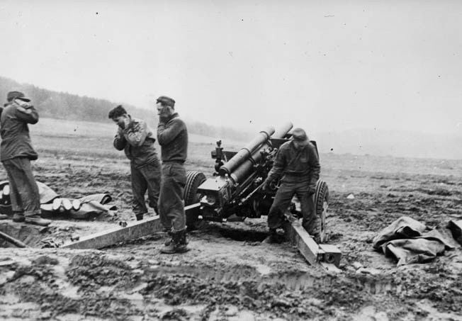 Gunners from a Seventh Army artillery battery pound German positions near Reipertswiller with their