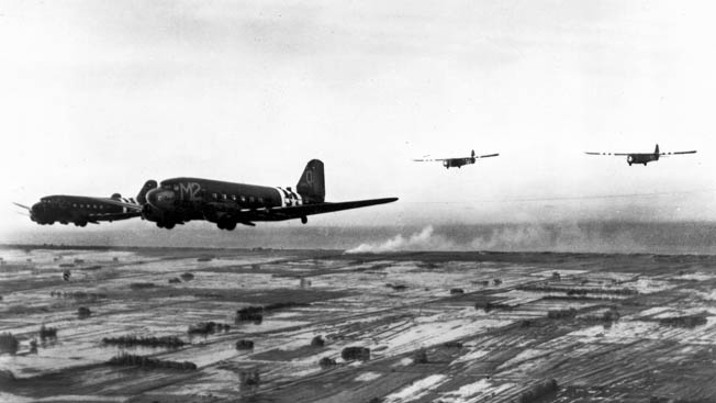 These C-47A aircraft are pictured towing gliders in the skies above Normandy in June 1944.