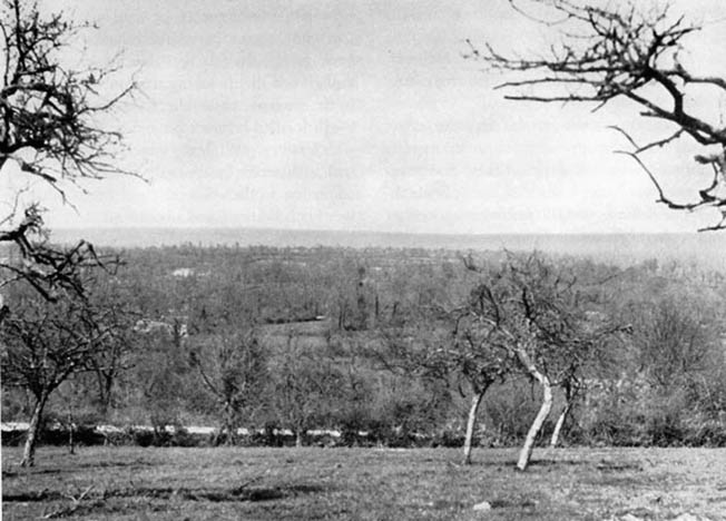 A view from the German-held orchard atop Hill 192. From this vantage point, the Germans could see any American advance toward them and call artillery and mortar fire down upon it.