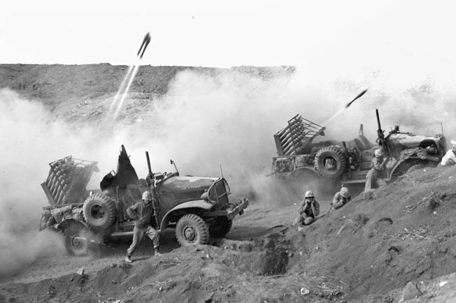 Marine rocketeers launch 4.5-inch projectiles toward Japanese emplacements on Iwo. The rocket units, being mobile, resorted to hit-and-run tactics to escape enemy counterfire.