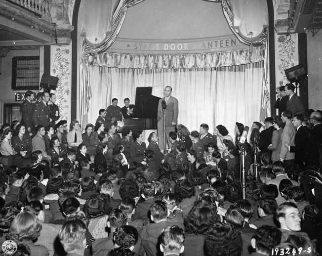 Bing Crosby performs for Allied troops during the opening performance of the USO Stage Door Canteen in Picadilly, London, August 1944.