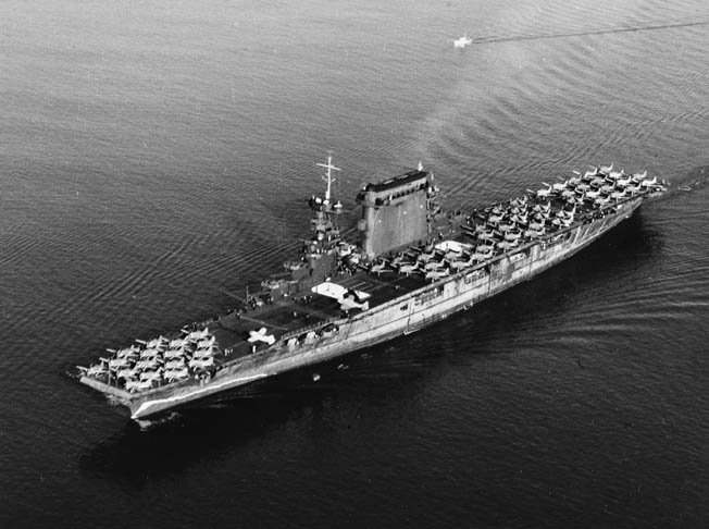 Leaving the harbor of San Diego, California, in October 1941, the aircraft carrier USS Lexington's deck is packed with aircraft, Including Brewster F2A-1 Buffalo fighters, Douglas SBD Dauntless dive bombers, and Douglas TBD Devastator torpedo bombers.