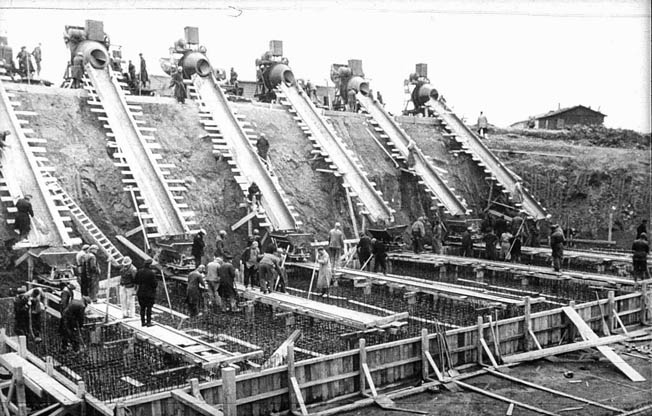 Large cement mixers pour the concrete for one of the casemates at Batterie Todt, the largest battery in France, located near Calais.