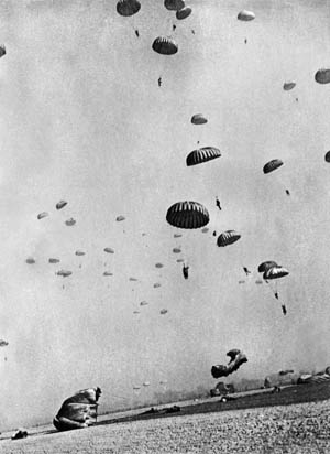 Parachutes fill the sky on March 24, 1945, in this image taken during Operation Varsity by famed Life magazine combat photographer Robert Capa, who jumped with the 507th Parachute Infantry Regiment, 17th Airborne Division.