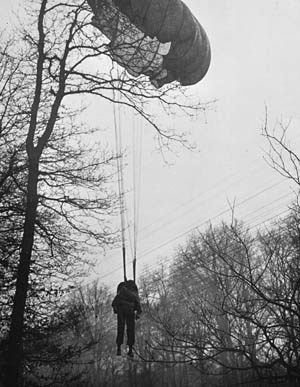 "Not all the sky soldiers landed safely. A member of Colonel Edson D. Raff's 507th PIR, known as the ""Rufficans,"" hangs from a tree near Wesel."