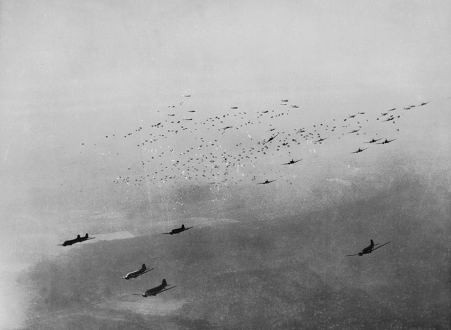 C-47 Skytrain transport planes release hundreds of Allied paratroopers and their supplies over the Diersfordt area east of the Rhine River. This picture was taken from a B-17 that was shot down shortly thereafter.