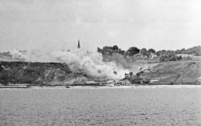 Smoke from exploding munitions blankets the entrance to the Vierville Draw on D-Day.