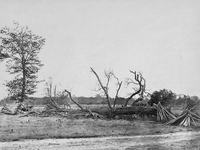 A blurry horseman is visible at the far left of this period photograph of hastily constructed breastworks on the far left of the Confederate line at Cold Harbor.