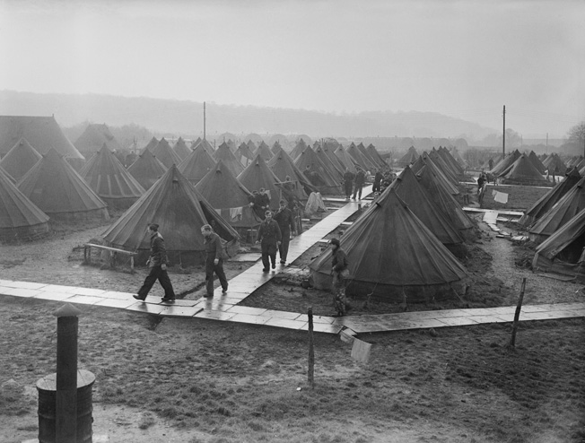 An unidentified POW camp in Britain, photographed in December 1945. While most of the camp consisted of tents, Nissen huts—prefabricated metal buildings, visible in the distance—also housed prisoners.