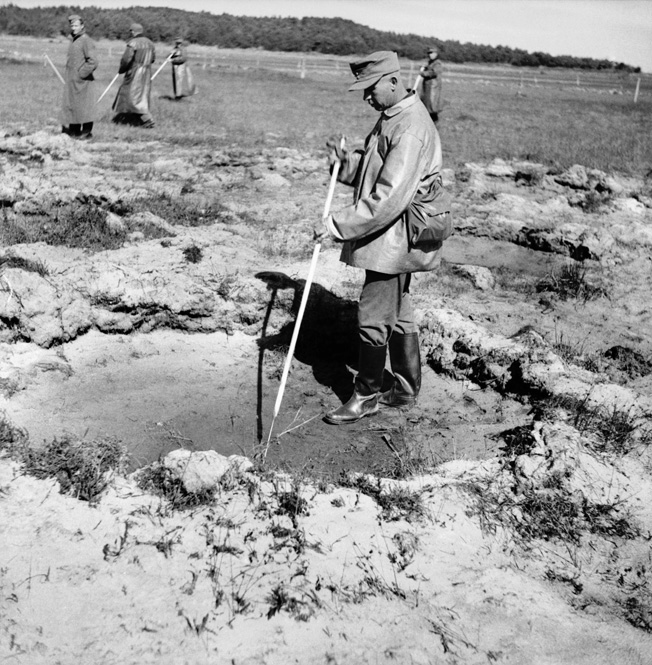 German prisoners engage in postwar mine-clearance work near Stavanger, Norway, August 1945. While most German POWs were repatriated after the war, some were held and required to perform such duties temporarily.