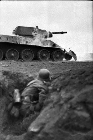 A German soldier practices assaulting a disabled Russian T-34 tank during field training in the Ukraine in the spring of 1944. Engler was wounded for a second time during a tank battle in the Ukraine in March 1944.
