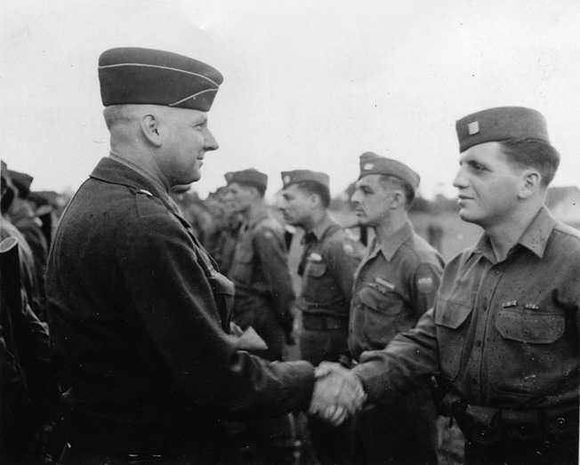 Brig. Gen. Andrew Tychsen, assistant commander of the 100th, awards the Bronze Star for Valor to the author, June 1945, at Kirschheim, Germany.