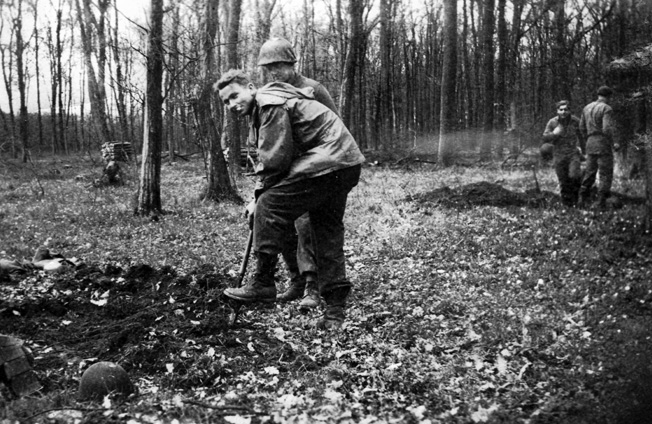 Pfc. Russell Hackett and other members of the author's platoon dig foxholes in preparation for an enemy counterattack in the Bitche area, November 1944.