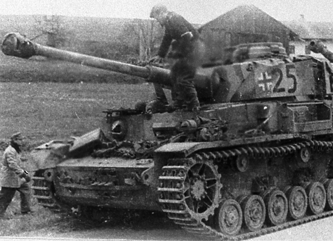 "The lead Tiger of the 11th Panzer Division makes its surrender to U.S. forces in Area ""B."""