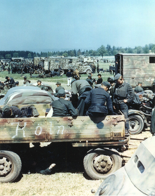 German POWs mill about awaiting transport after surrendering to the U.S. 1st Infantry Division in Czechoslovakia.