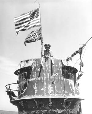 Capt Daniel V. Gallery, commander of the escort carrier USS Guadalcanal, stands in the conning tower of the captured German submarine U-515