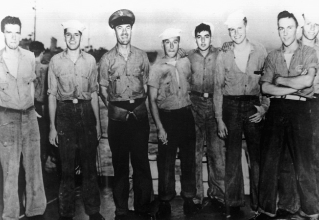 Crewmen of the destroyer escort Pillsbury are shown celebrating the capture of the submarine U-515. These men were members of the first boarding party to reach the German vessel.
