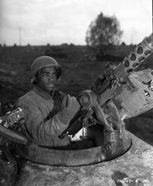 This soldier is manning a cupola-mounted .50 M2 Browning machine gun. Sergeant Sam Turley used his tank's M2 machine gun to cover his men, until getting killed by an 88mm shell.