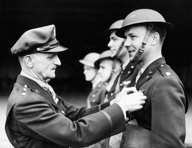 "General Carl A. ""Tooey"" Spaatz pins the Distinguished Service Cross on the chest of Captain Charles Kegelman, who led the first U.S. Army Air Forces bombing strike against Nazi-occupied Europe on July 4, 1942."