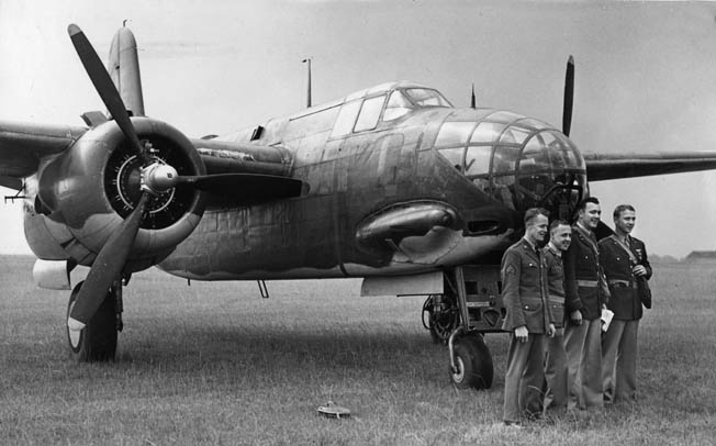 Captain Charles Kegelman, commander of the first U.S. Army Air Forces bombing raid on targets in Nazi-occupied Europe, poses with other members of his crew in front of its Douglas A-20 Havoc light bomber. Royal Air Force A-20s accompanied the American planes on their first mission.