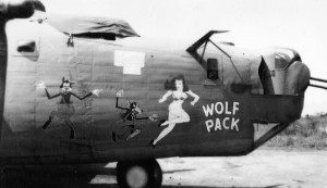 """Wolf Pack"" was one of the B-24 Liberator bombers flown by Lieutenant Herbert Goodrich. Note the distinctive nose art and the twin .50-caliber machine guns in the nose that were used to defend against Japanese fighter planes."