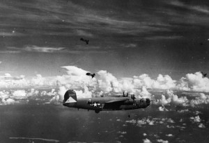 Flak bursts darken the sky around a flight of B-24 Liberator bombers on a mission. The versatile B-24 proved effective on high-altitude and antishipping missions, while also functioning in an antisubmarine role.