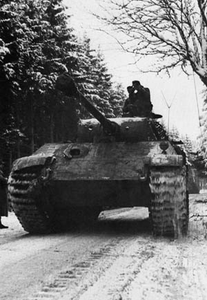Originally conceived in response to the highly successful T-34, a German Panther medium tank, with a high velocity 75mm cannon, rolls rapidly through the Ardennes Forest in December 1944.