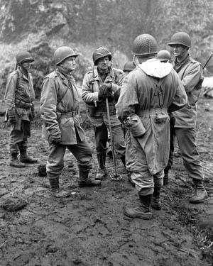 Lt. Gen. Simon Bolivar Buckner Jr., head of Alaska Defense Command, talks with subordinate commanders during operations on Attu in June 1943.