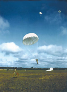 U.S. paratroopers plummet earthward during training exercises. In order to earn their paratrooper wings, Soldiers had to complete five successful practice jumps.