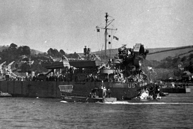Damaged by German E-boats during Operation Tiger, a D-Day training exercise, LST-289 sits forlornly with its stern blown off. German Torpedo attacks wrecked havoc during the exercise on April 28, 1944, and resulted in hundreds of casualties.
