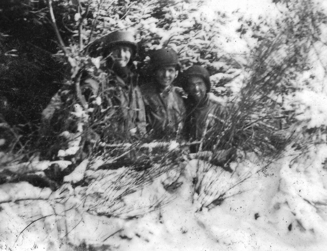 Another photo taken by Carmen Gisi shows men of Company B in their snowy foxhole near Bastogne. Gisi is at far right in this group.