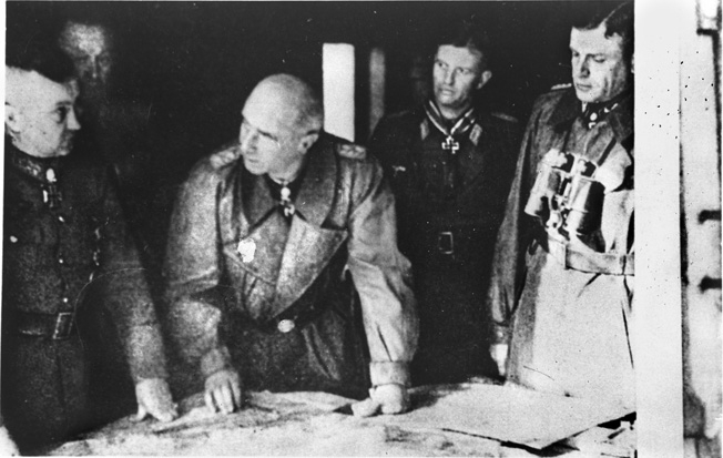 Senior German officers gather for a briefing to respond to the Allied offensive code-named Operation Market-Garden. Left to right are Field Marshal Walter Model, Colonel General Kurt Student, Major General of the Waffen SS Wilhelm Bittrich, Major Hans Peter Knaust, and Major General of the Waffen SS Heinz Harmel.