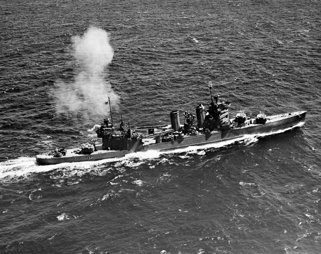 The USS Astoria fires its 8-inch guns during gunnery practice off Hawaii in July 1942. Within minutes of meeting the Japanese off Savo Island, the Astoria was in flames.