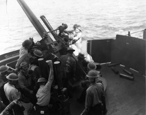 The crew of the USS Astoria's No. 3 gun, a 5-inch weapon, works feverishly during the gunnery practice in the spring of 1942.