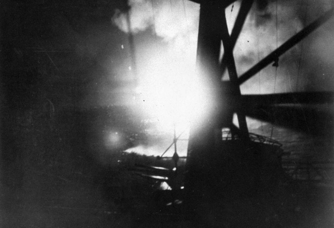 This photograph taken from the deck of the Japanese cruiser Chokai shows flares illuminating the American cruiser USS Chicago and the Australian cruiser Camberra on the night of August 8-9, 1942.