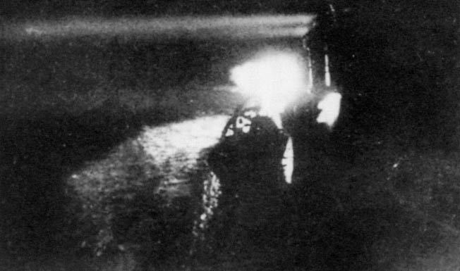 A searchlight aboard the Japanese cruiser Yubari scans the blackness near Savo Island for targets. The Japanese were well trained in night fighting and utilized the superb Long Lance torpedo to deadly effect during the battle.