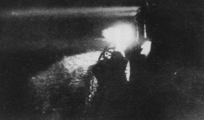 Search and destroy: The Japanese cruiser Yubari uses its searchlights to seek out the Northern Fleet.