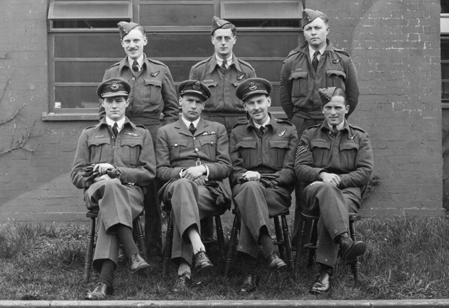 Squadron Leader J.D. Nettleton, awarded the Victoria Cross for heroism during the Augsburg raid, sits second from left with his crew shortly after the raid. Nettleton was killed in action during a raid on the Italian city of Turin a year later.