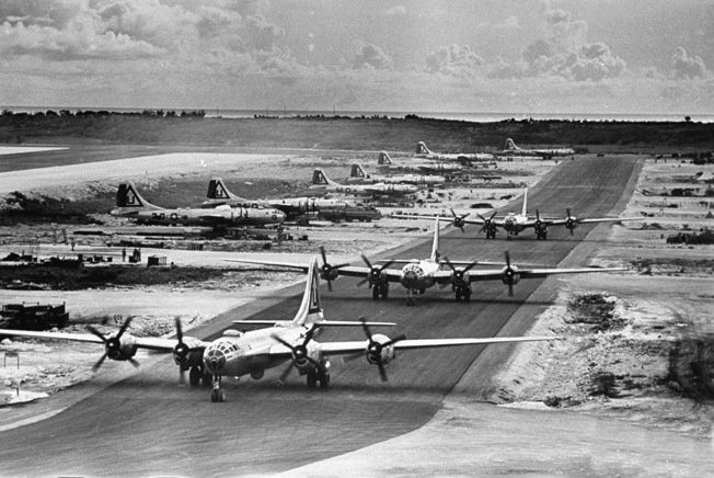 Taxiing into position for takeoff from West Field on the island of Tinian in the Marianas, Boeing B-29 Superfortress bombers of the 462nd Bomb Group set out on a mission against a major Japanese city.