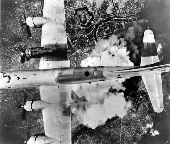 During a daylight raid on the Japanese city of Osaka, American B-29 bombers drop their payloads on the target far below. This raid took place in June 1945, and within weeks the war in the Pacific was over.