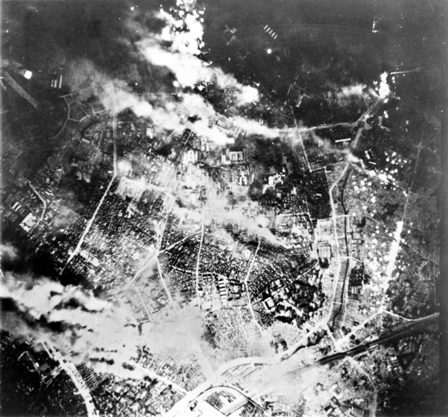 Tokyo burns fiercely following one of numerous American firebomb raids. This attack was conducted in May 1945, two months after the devastating raid of March 9-10.