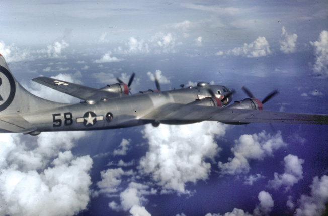 Shown in flight, this B-29 Superfortress of the 40th Bombardment Squadron, 6th Bombardment Group stays in formation during a mission to bomb a target in the home islands of Japan. Late in the war, major military and industrial targets became scarce after bombers laid waste to much of Japan's infrastructure.