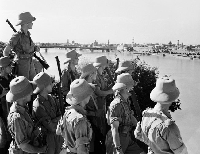 Armed with Enfield rifles, British troops view Baghdad from across the Tigris River, June 1941.