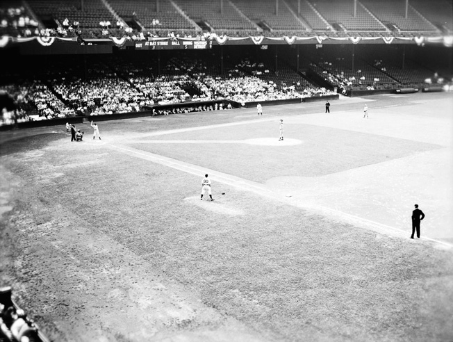 Fans crowd the stadium for a game between the Detroit Tigers and the Cleveland Indians in 1942. President Franklin D. Roosevelt asserted that continuing to play major league baseball was essential to the national morale.